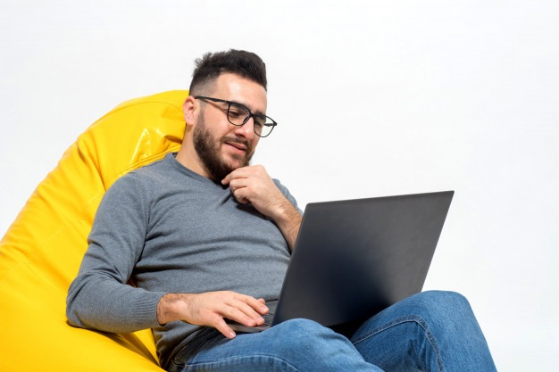 Guy thinks about something while work Free Photo